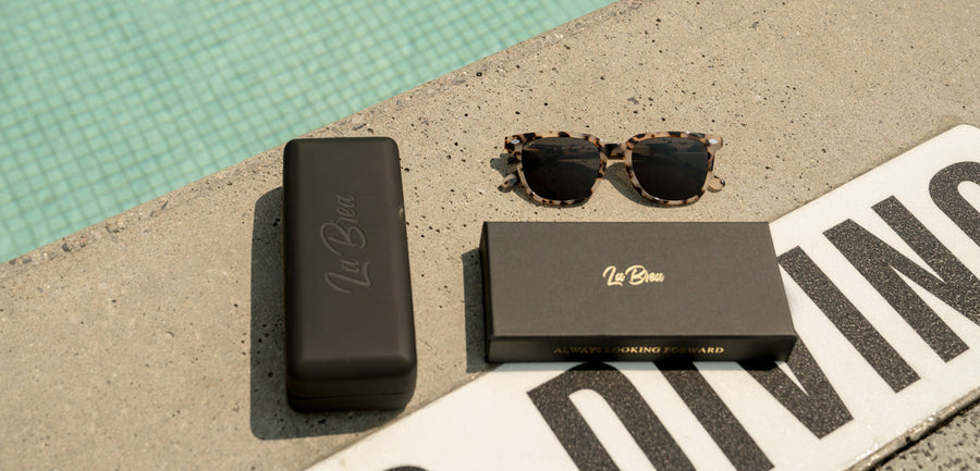 La Brea Grove White Tortoise sunglasses by the pool