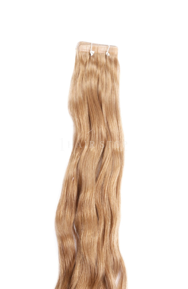 Dark honey blonde human hair tape-in extensions