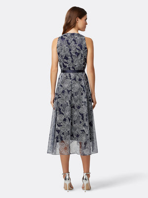 Back View of Women's Designer Hi Lo Dress with Ribbon Bow in Navy with Silver Flowers | Tahari ASL Navy Silver Floral