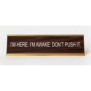 I'm Here. I'm Awake. Don't Push It. Nameplate