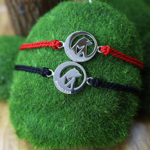Round charm with red thread bracelet