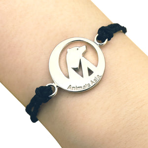 Round charm with black thread bracelet