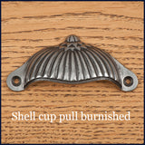 Shell burnished cup pull