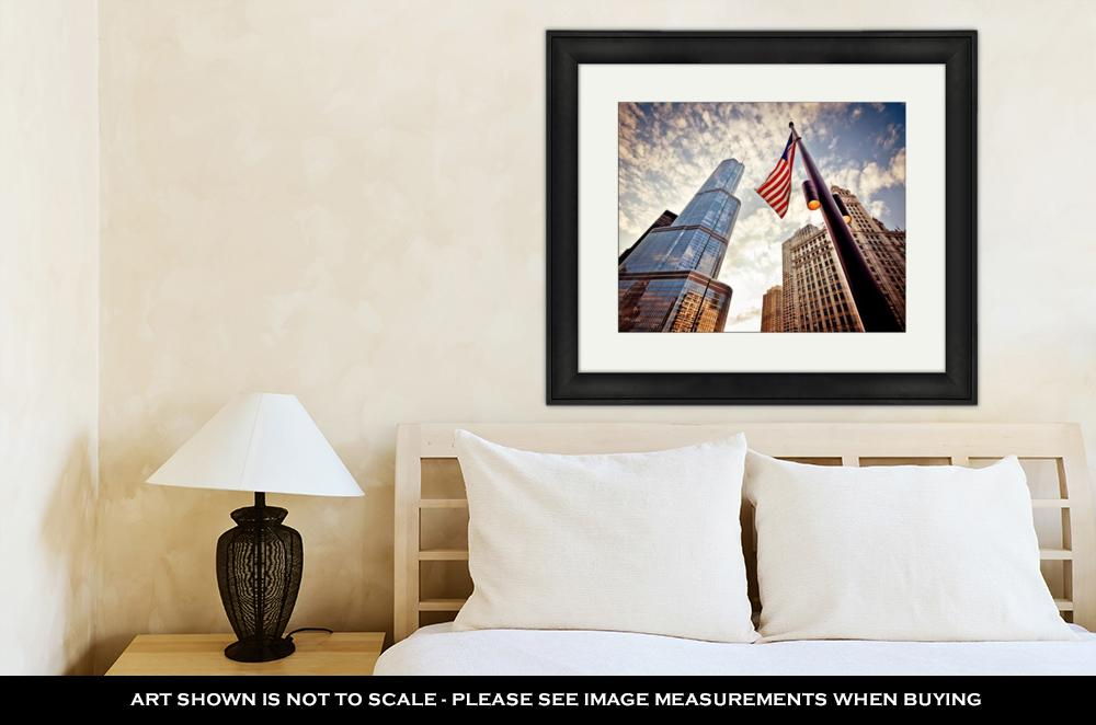 Framed Print, American Flag Over Skyscrapers