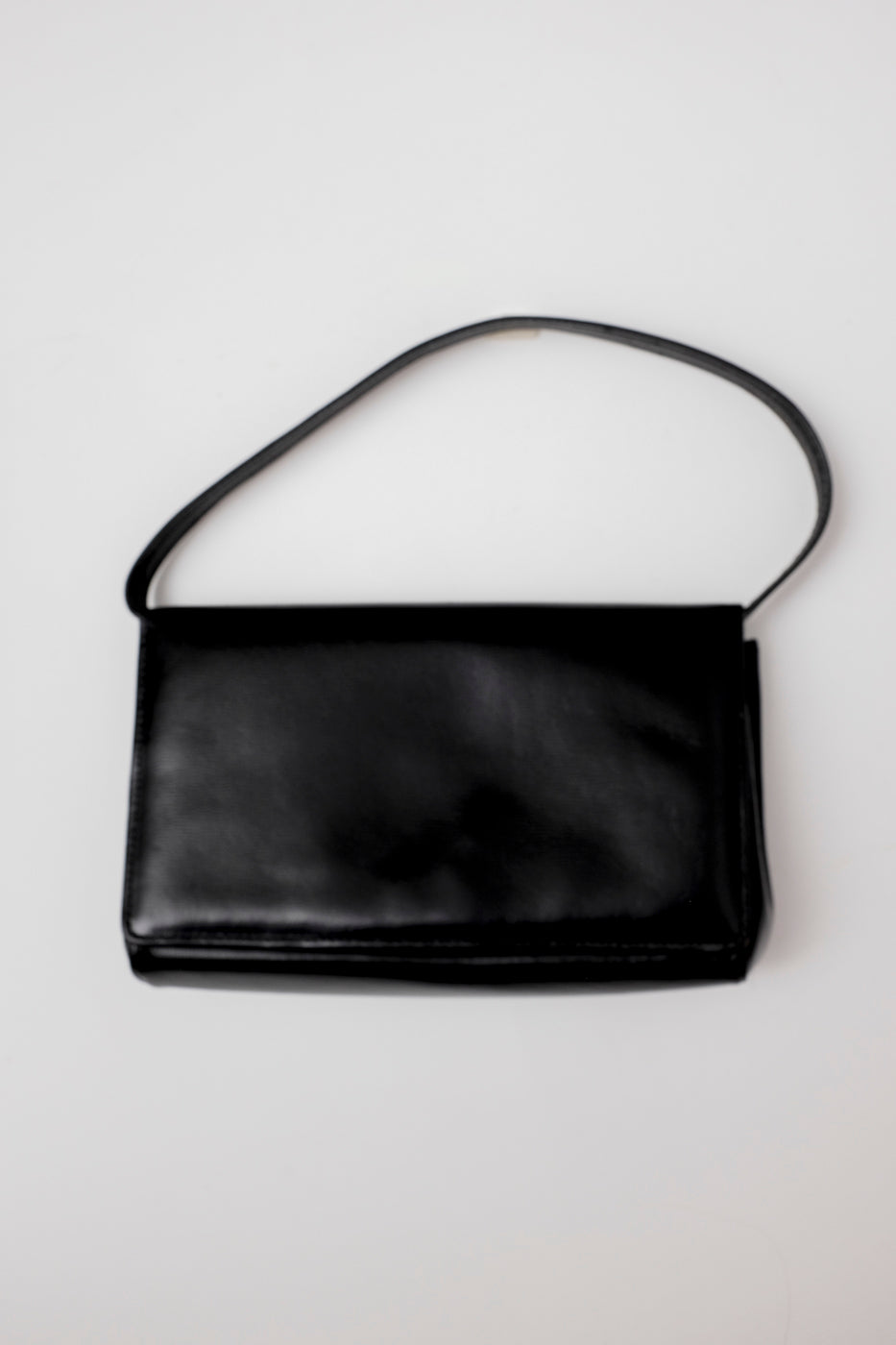 0003_CLEAN UNDER ARM LEATHER BAG