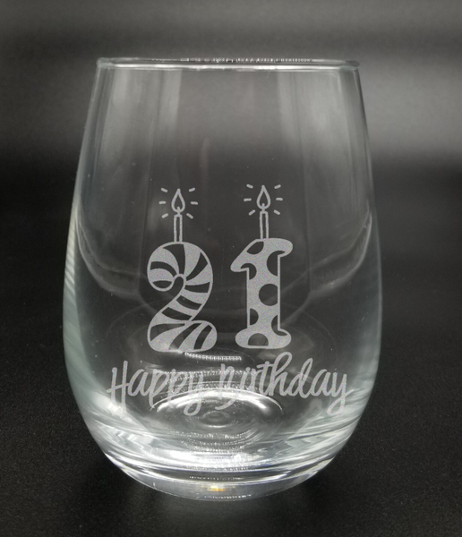 "This etched glass features a ""2"" and ""1"" candle with ""Happy birthday"" written in script underneath. Comes in either a beer mug, stemless wine glass, or stemmed wine glass."