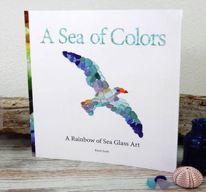 Kids book with coastal images made from sea glass. Very colorful