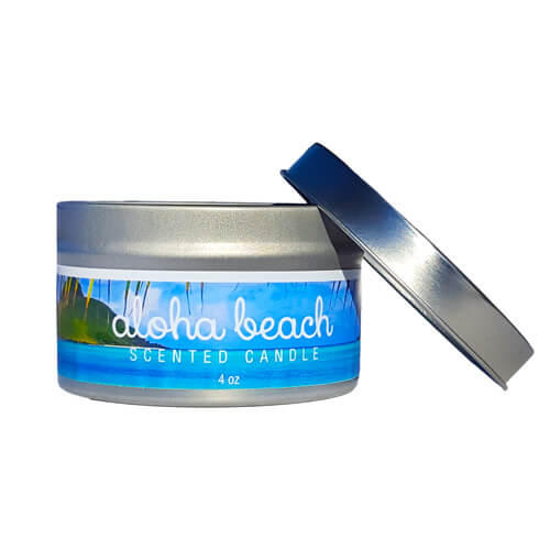 Blue soy candle in metal tin with beach scene on front