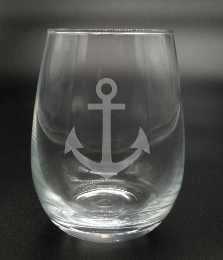 Nautical anchor etched on either a wine glass or a beer mug