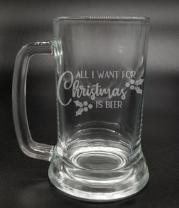 """All I want for Christmas is beer"" with holly leaves and berries etched on the front of a beer mug"