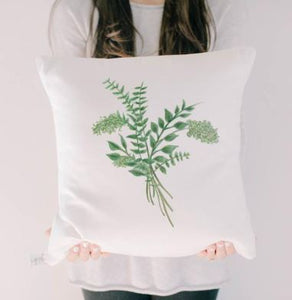 "18"" White throw pillow with a green print of eucalyptus printed on the front."
