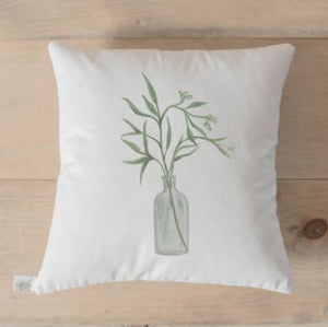 "18"" White throw pillow features a print of a eucalyptus bunch in a vase"