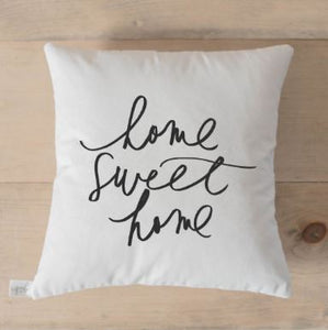 "18"" white throw pillow with ""home sweet home"" in black script letters on the front"