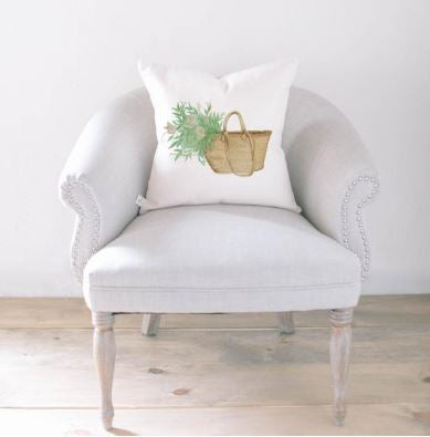 "18"" white throw pillow with a watercolor basket with flowers in it on the front"