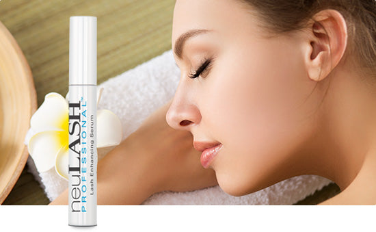 neuLash professional with girl relaxing in background on massage bed