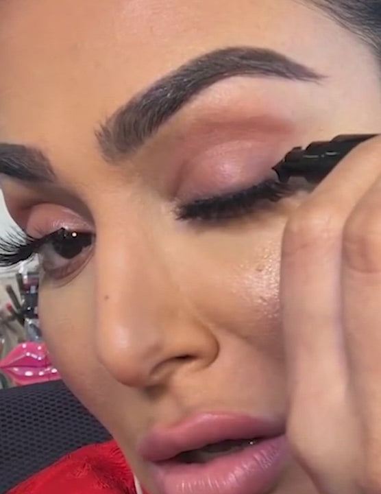 Huda Kattan wearing Intense Black in Grand