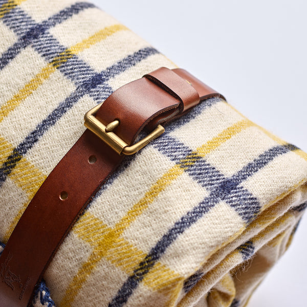 Fox-Brothers-Spring-Tattersall-Check-Wool-Blanket-Interior-Design-woven-in-Somerset-handfinished-blanket-stitched-edge-Fox-Flannel-The-Merchant-Fox-oak-bark-tanned-blanket-strap-close-up