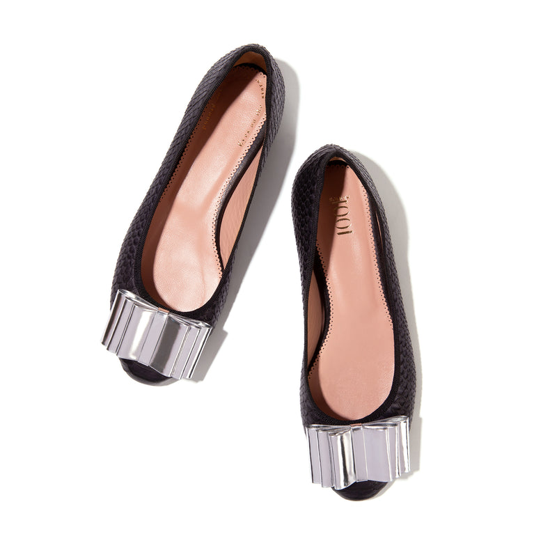 Black leather snake pattern ballet flats with silver bow