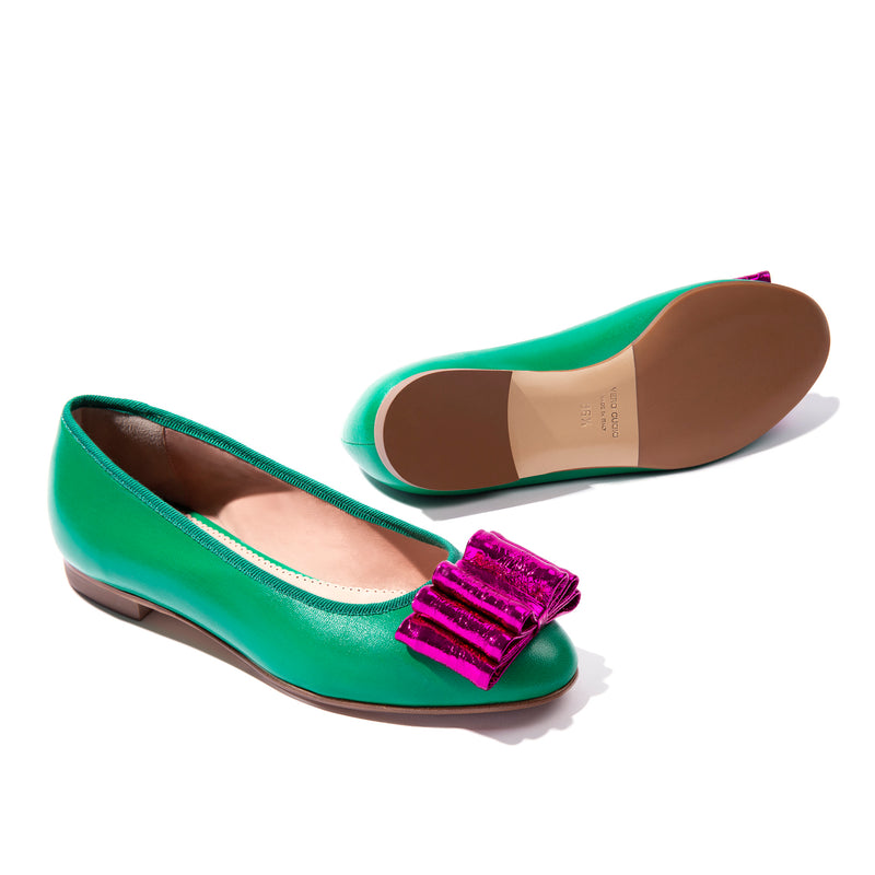 Green leather ballet flats with fuchsia bow