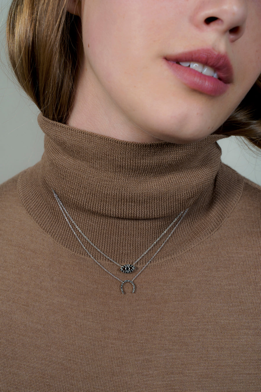 Petite black horseshoe necklace