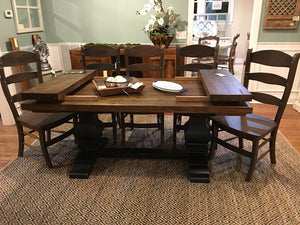 "72"" x 38"" Dewey Table made of heart pine with a natural finish on tabletop and distressed black on base. Please note that the extensions shown are not included in this product."