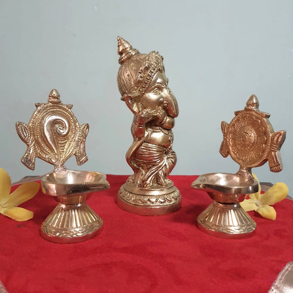 Flute Ganesh Brass Idol & Shanku and Chakra Diya Set-Crafts N Chisel - Indian handicrafts home decor USA