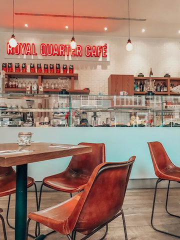royal quarter cafe neon and pastry case