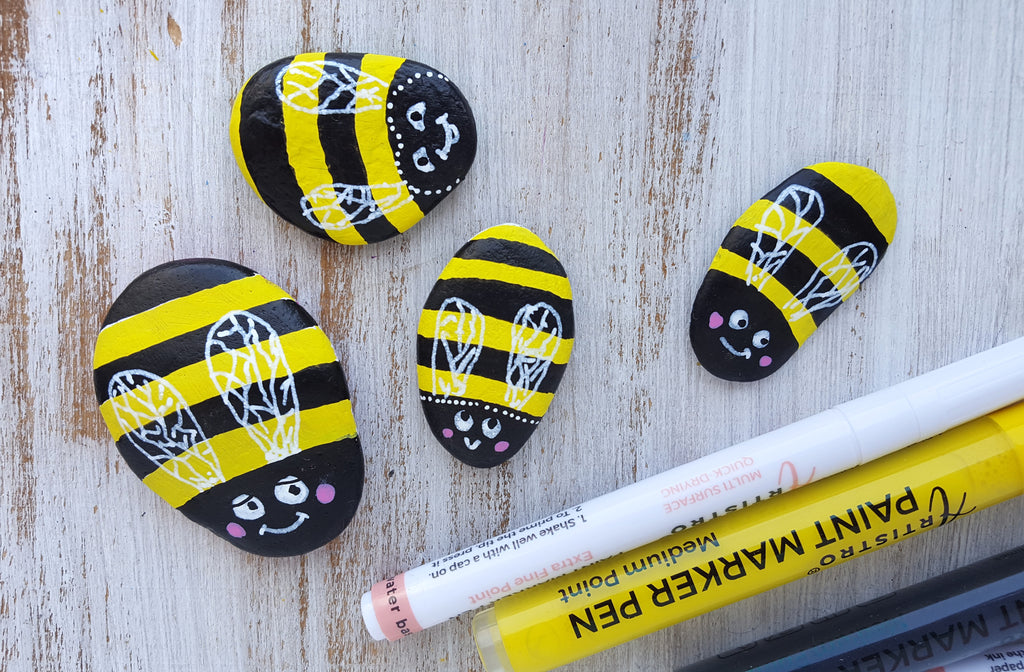 bee painted on rocks
