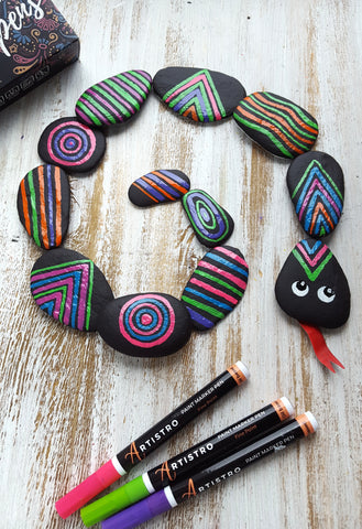 snake painted on rocks