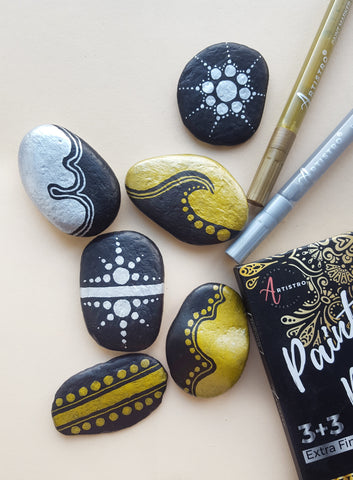 gold and silver painted rocks