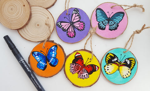 butterfly painted wood slices