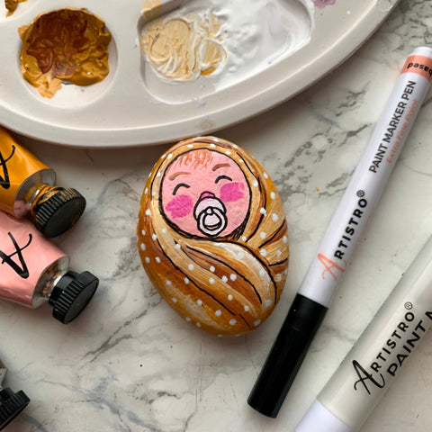 Cute baby stone painting