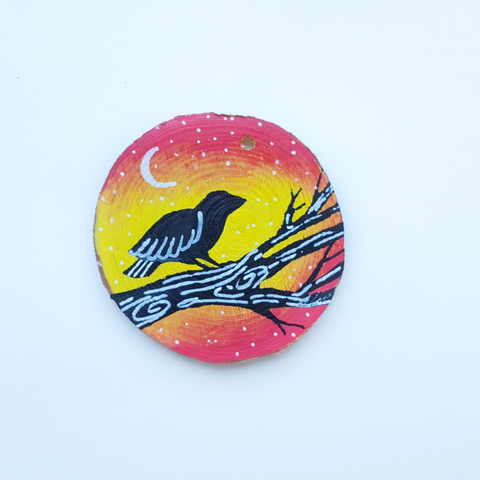 bird painted on wood slice