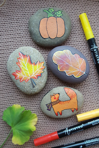 rock painting with autumn leaves