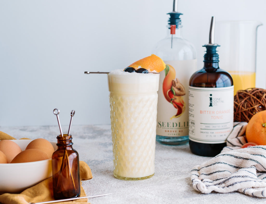 A mocktail version of a Ramos Gin Fizz made with Iconic Bitter Orange Tonic and Seedlip