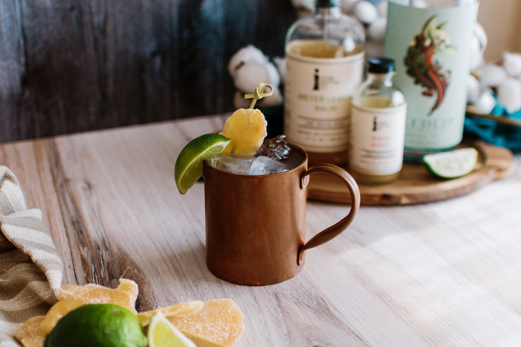 A mocktail version of a Moscow Mule made with Iconic Ginga Syrup and Meyer Lemon Balm with Seedlip Spirits