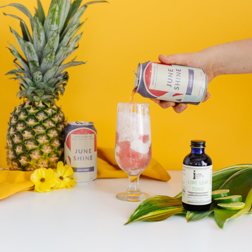 A low ABV Pina Colada inspired float made with Iconic Lime Leaf Tonic and Juneshine Acai Berry Hard Kombucha.