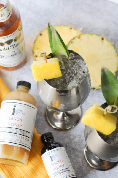 Explore different dark spirits like a tropical rum to make a different kind of Moscow Mule. If you need a fiery ginger syrup, be sure to try Iconic's Ginga Syrup!