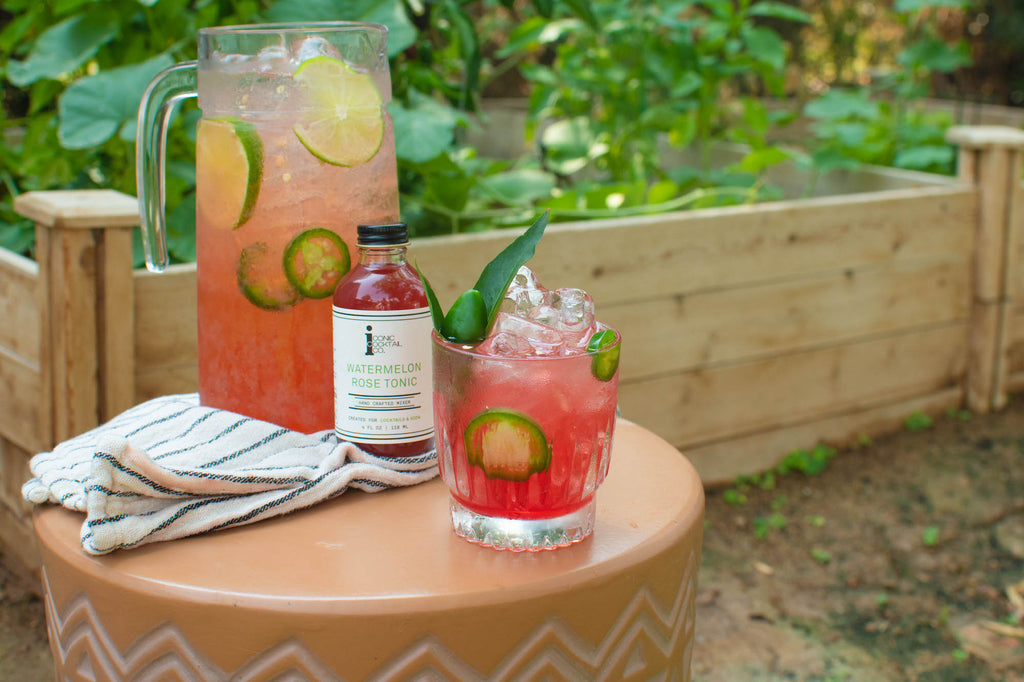 A pitcher of spicy margaritas made with Iconic Watermelon Rose Tonic. Perfect for summer or celebrating National Watermelon Month!