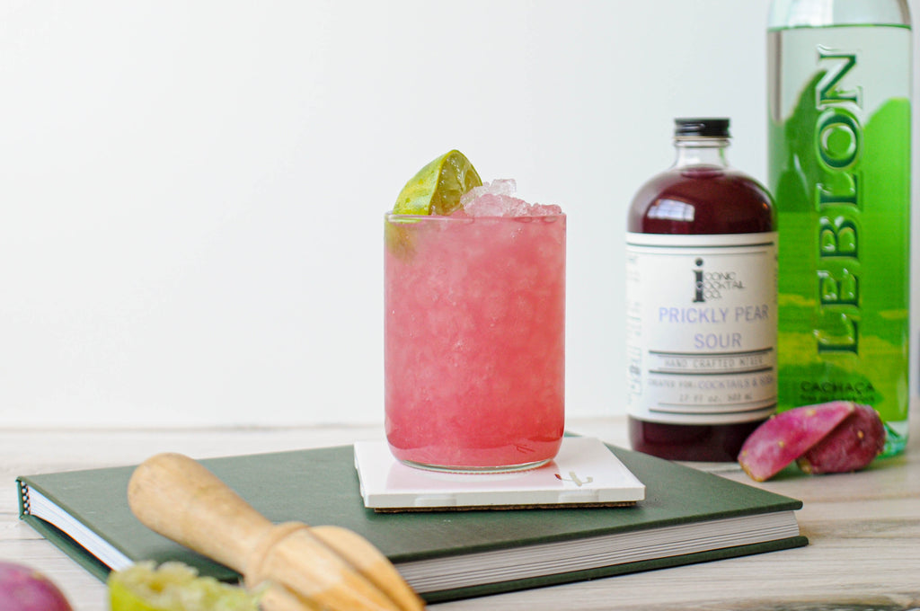 Prickly Pear Caipirinha: Inspired by Brazil's national drink, this Caipirinha is made with Cachaca, fresh limes, and Iconic Prickly Pear Sour for extra color