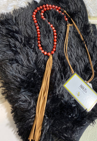 FROSTED RUST BEADED NECKLACE WITH SUEDE TASSEL