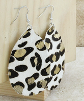 WHITE LEOPARD HIDE WITH GOLD EARRINGS