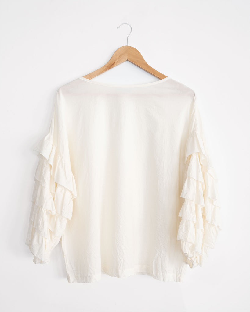light weight, organic cotton, ruffle sleeve relaxed fit blouse. Made in Melbourne. Sustainable style.