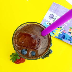 SMOOV berry exotic blend stirred into a glass of water to help kids get their fruits in a healthy and easy way!