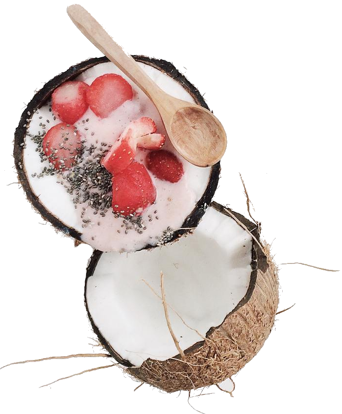 A smoothie bowl where the bowl is a coconut shell. It is made with a dash of Smoov's blush blend and thick and creamy in consistency and topped off with sliced strawberries.