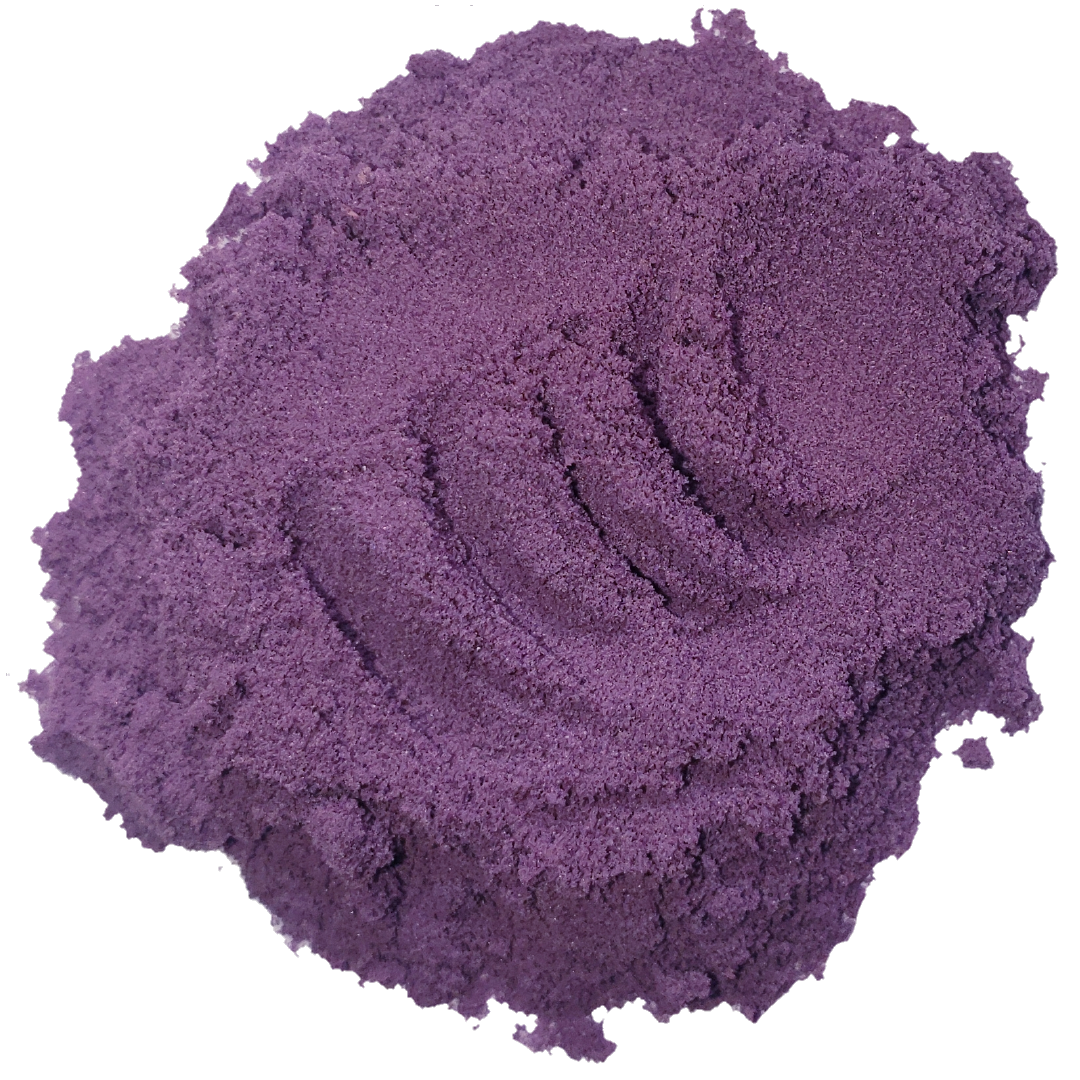 Spoon of vibrant purple, black goji berry powder from Smoov Blends