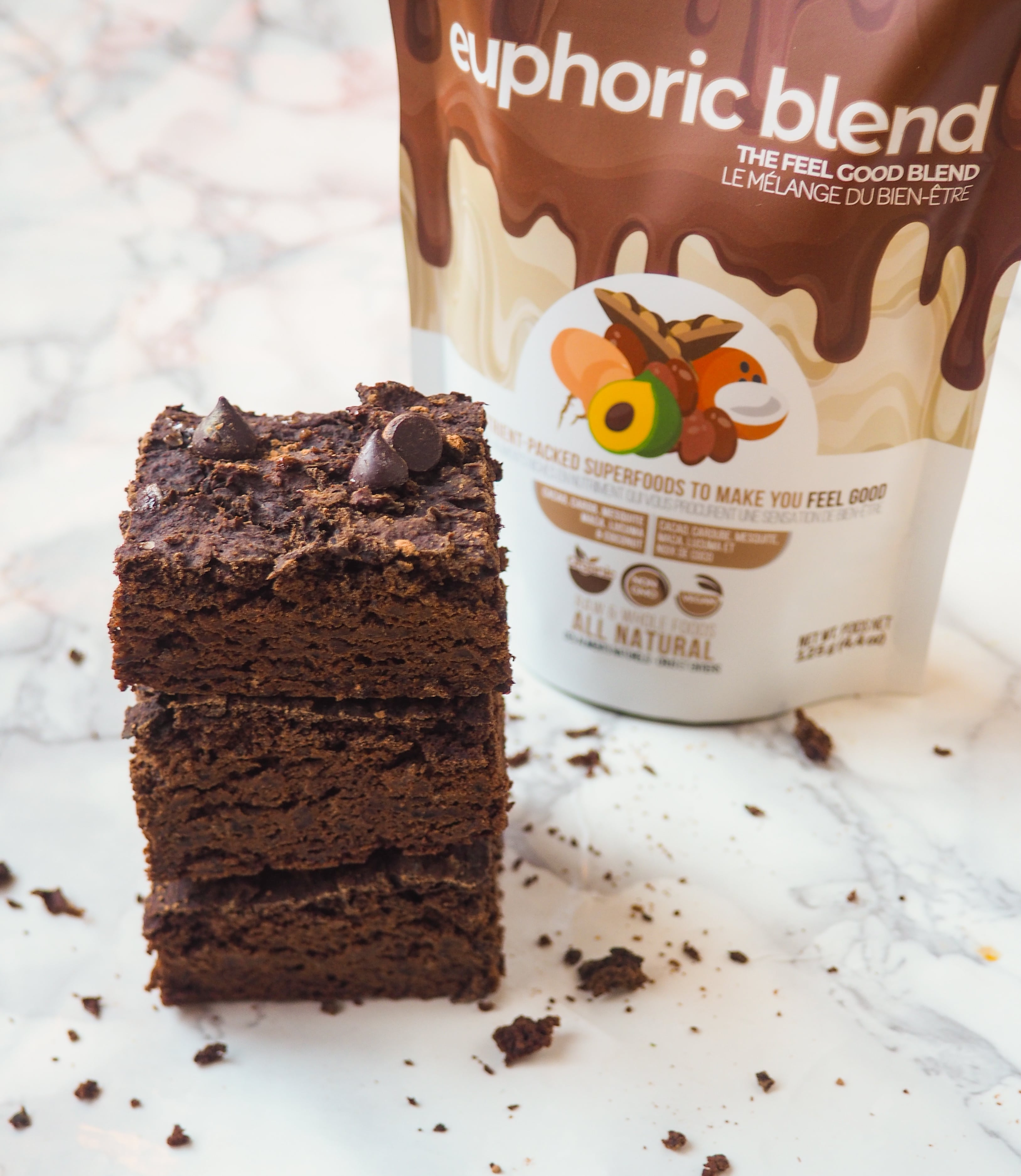 Chocolate banana brownies made using our superfood euphoric blend. Our euphoric blend has 6 powerful and delicious foods packed with antioxidants, healthy fats and adaptogens- Raw cacao, Carob, Mesquite, Maca, Lucuma and shredded Coconut. A healthy way to satisfy cravings and boost mood instantly!  Sustainably sourced, 'Better-than-fair-Trade', our blends are certified organic and plant-based making it vegan friendly with no added sugar!