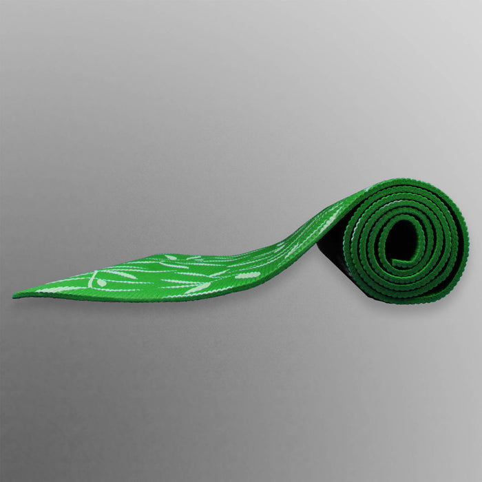green rolled up yoga mat