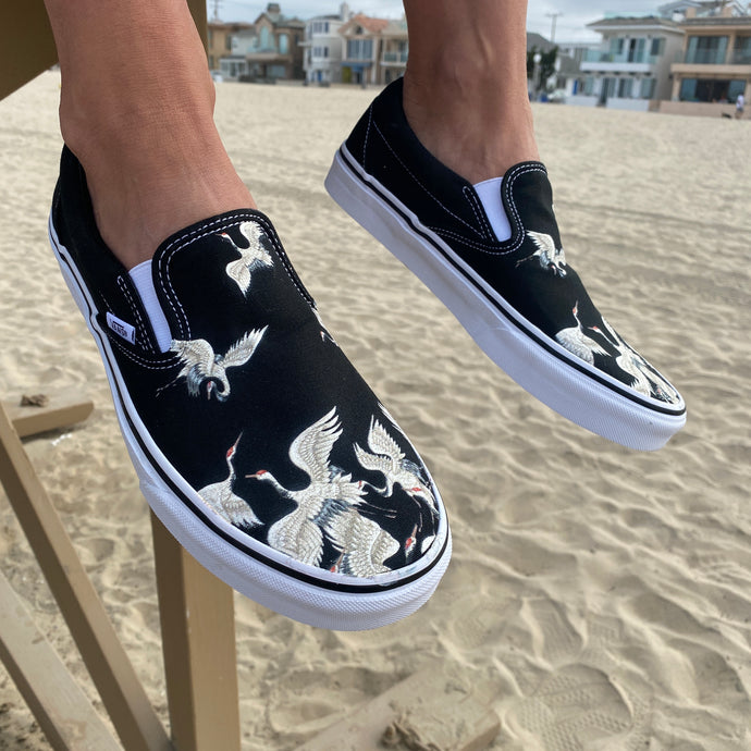 Take-Off Wearing These White Cranes on Black Slip-on Vans