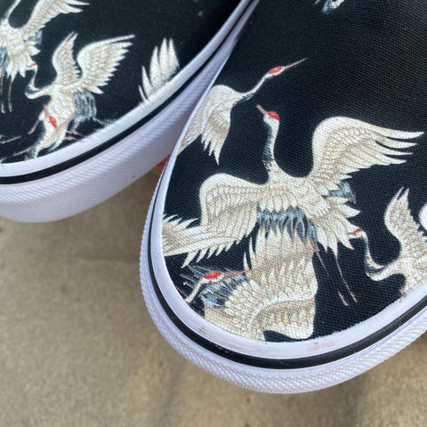 White Cranes on Black Slip-on Vans